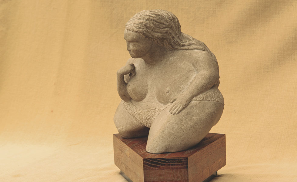 Fat Lady carved stone sculpture