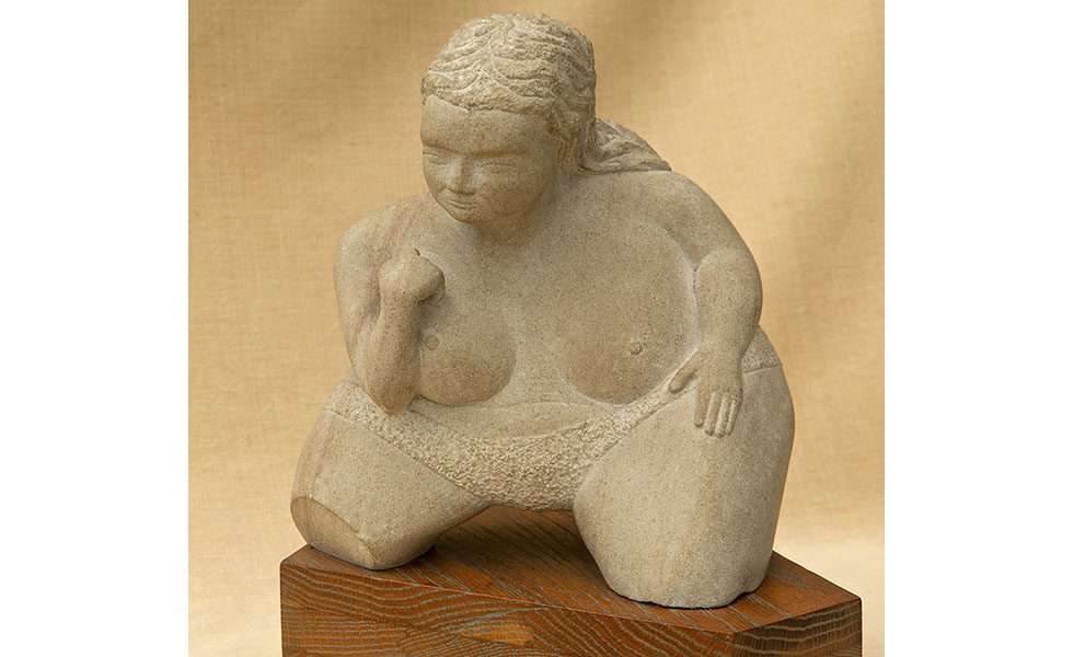 Fat Lady carved limestone sculpture