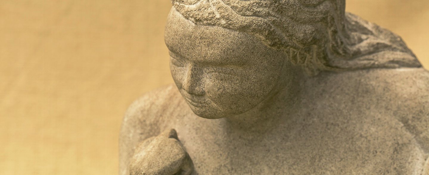 Fat Lady limestone carving