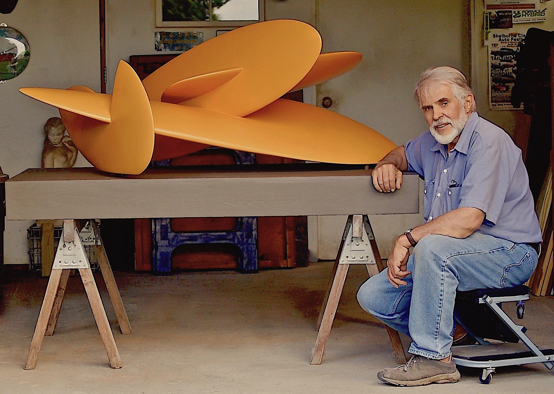 Sculptor Don Perdue with his Trains and Planes sculpture